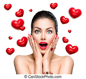 Beauty fashion surprised woman with flying red hearts