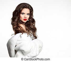 Beauty fashion Woman in Luxury Fur Coat isolated on white background. portrait of a young beautiful brunette girl with long wavy hair and red lips makeup.