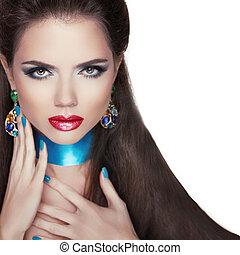 Beauty Fashion Woman Portrait. Jewelry accessories. Colourful gemstones.
