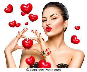 Beauty fashion woman showing red heart in her hand