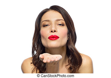 beautiful woman with red lipstick blowing air kiss