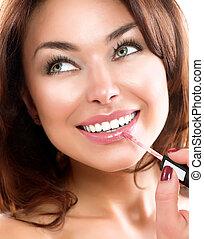 Beauty Girl Applying Lipgloss. Makeup. Beautiful Woman's...