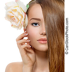 Beauty Girl. Beautiful Model with Rose Flower Touching her Face