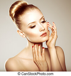 Beauty girl. Beautiful young woman. Stylish model with perfect skin, manicure and make-up. Updo. Hairstyle at hair.