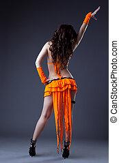 Beauty girl dance in orange go-go costume