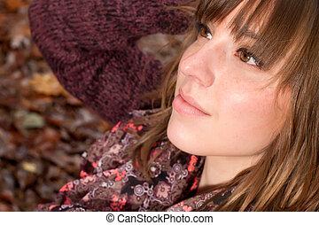 Beauty girl face in the autumn