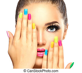 Beauty girl face with colorful nail polish. Manicure and makeup