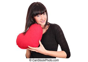 girl holding a heart