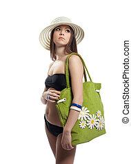 Beauty girl in black bikini with green beach bag