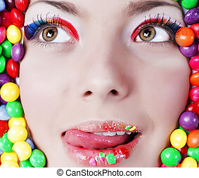 Beauty girl in candys - Portrait of young beauty girl in...