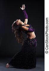 beauty girl in oriental arabic costume dance