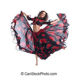 Beauty girl jump in gypsy dance isolated
