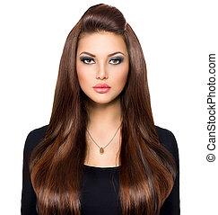 Beauty Girl Looking at Camera. Long and Shiny Brown Hair