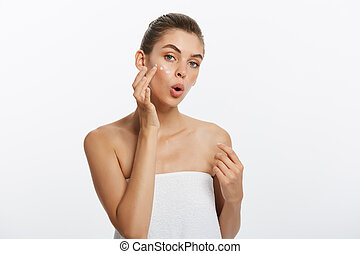 beauty girl of caucasian woman checks her skin, skin care, acne treatment.