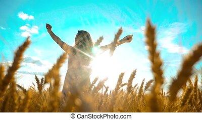 Beauty girl outdoors enjoying nature wheat field slow motion...
