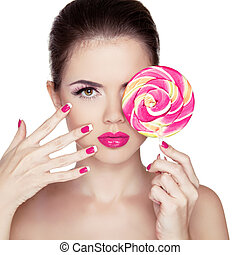 Beauty Girl Portrait holding Colorful lollipop. Fashion makeup. Nail polish manicured nails. Skin care. Isolated on white background. Colourful Studio Shot of Funny Woman.