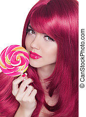 Beauty Girl Portrait holding Colorful lollipop. Glamour makeup. Nail polish manicured nails. Isolated on white background. Colourful Studio Shot of Funny Woman.