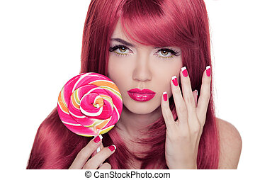 Beauty Girl Portrait holding lollipop with Colorful Makeup, Coloring Pink Hair, Manicured nails.