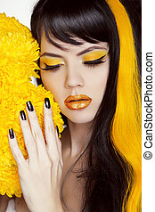 Beauty Girl Portrait with Colorful Makeup, Long Hair, Nail polish. Manicure and Hairstyle. Black and yellow Colors