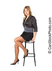 Beauty girl sits on bar stool
