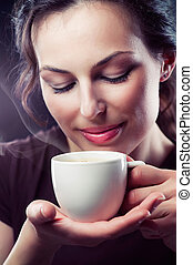 Beauty Girl With Cup of Coffee or Tea