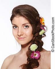 Beauty girl with flowers in her hair