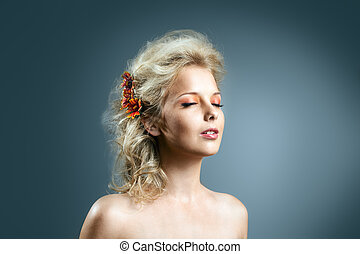 Beauty girl with hair style and autumn flower