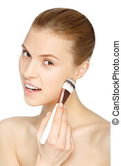 Beauty Girl with Makeup Brush. Natural Make-up. Nude...