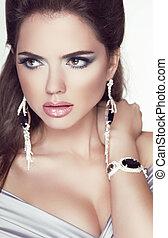 Beauty glamour Brunette Woman Portrait. Trendy Fashion Jewelry accessories.
