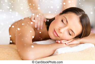 beautiful young woman in spa salon getting massage