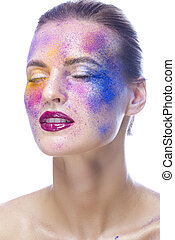 Beauty Ideas. Beauty Closeup Portrait of Tranquil Caucaisan Girl With Closed Eyes and Powder Colorful Artistic Makeup Across The Face On White. Vertical Image