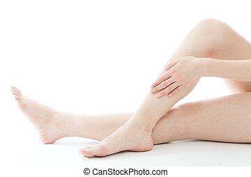 Beauty image - Beautiful young woman legs on white ...