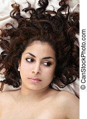 Beauty in bed - Beautiful middle eastern teenage girl lying...
