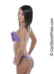 Beauty in bikini. Attractive young woman in bikini posing while isolated on white
