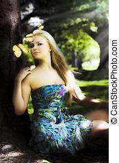 Beauty In Nature - Beautiful Glamorous Blonde Woman Sitting...