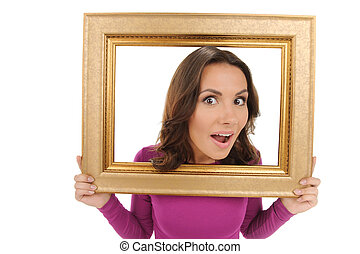 Beauty in picture frame. Beautiful young women looking through picture frame and smiling while isolated on white