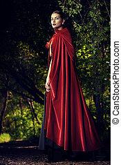 beauty in red cloak - Beautiful brunette woman in black...