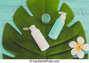 organic lotions and skincare products with tropical flowers ...