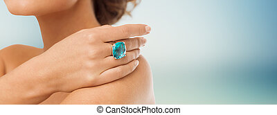 close up of woman with cocktail ring on hand - beauty,...