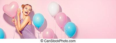 Beauty joyful teenage girl with colorful air balloons having...