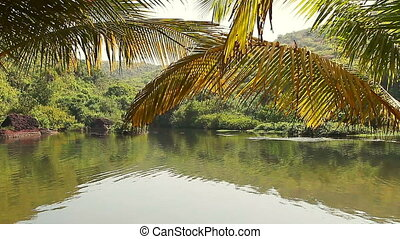 Beauty lake with palm trees at early motning