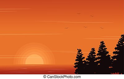 Beauty landscape of lake with spruce silhouettes