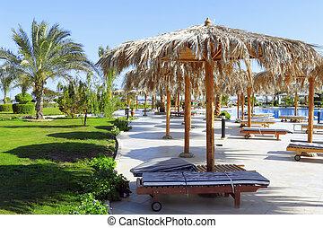 Beauty landscape of sun umbrella, make of reed. - Beauty...