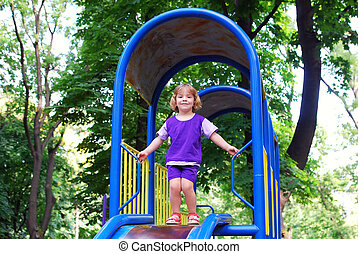 beauty little girl in playground