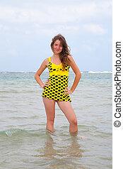 girl in yellow dress at sea
