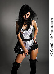 beauty maid - beauty model in maid clothes on gray