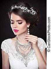 Beauty makeup. Elegant hairstyle. Brunette girl model. Fashion earrings jewelry
