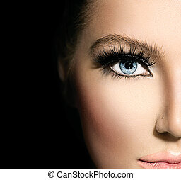 Beauty makeup for blue eyes. Part of beautiful face closeup