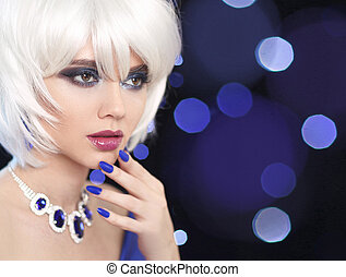 Beauty makeup. Manicured nails. Bob Blond Girl. Fashion jewelry. Fashionable Portrait Woman. White Short Hair. Gems necklace. Face Close up. Hairstyle. Fringe. Vogue Style.