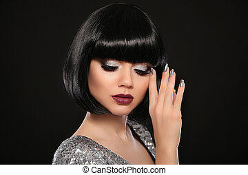 Beauty Makeup, Silver Manicured polish nails. Bob hairstyle. Fashion Style Brunette Woman Portrait with black Short Hair and glitter lips isolated on black background. Presenting your jewelry set.